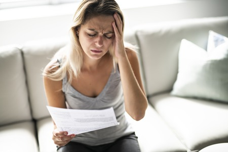 Blonde Beautiful woman stressed because of bills