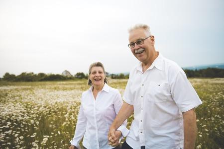 Senior couple outdoors Foto de archivo