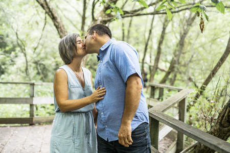 couple embracing each other having walk in the summer forest Banco de Imagens