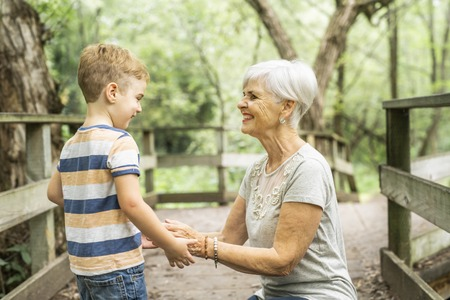 Grandmother and grandson spend the weekend in the park