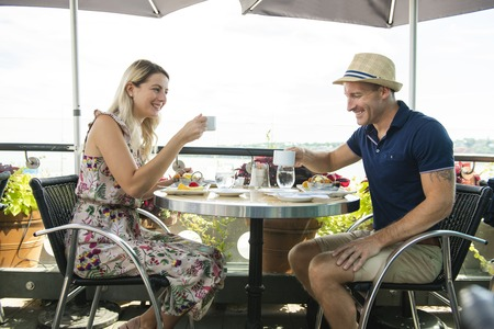 Tourist Couple doing breakfast on a restaurent Archivio Fotografico