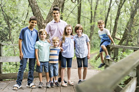 Fun time for family children in summer forest