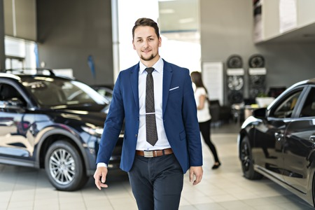 Business man working at a car dealer Stock Photo