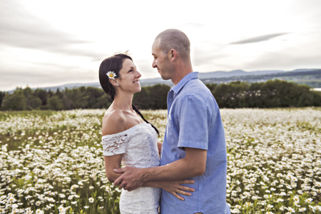 couple in love outdoor at the sunset daisy Banco de Imagens