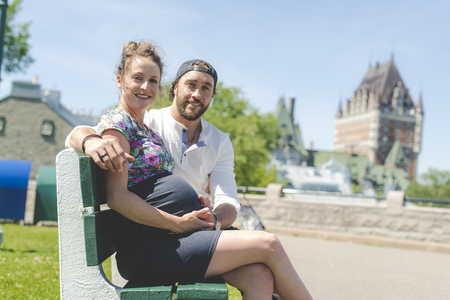 Pregnant couple portrait outside in Quebec city Standard-Bild