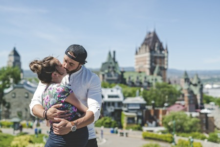 Pregnant couple portrait outside in Quebec city Stock Photo