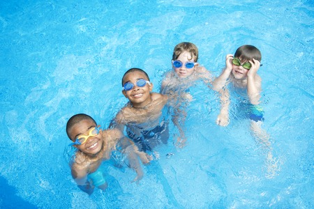 Children in outside swimming pool