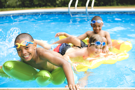 A children group in outside swimming pool Stock Photo