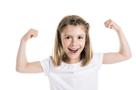 Portrait of a cute 7 years old girl Isolated over white background show her strength