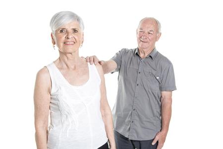 Senior couple posing on studio white background