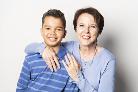 black Boy with grandmother in studio white background