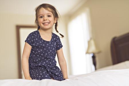 A cute Little beautiful girl on bedroom