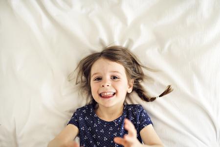 Little beautiful girl on bedroom Stock Photo