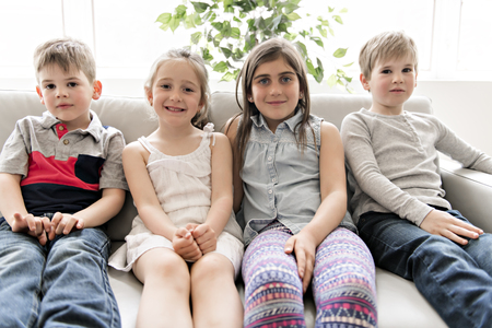 Group Of Young Friends Together on the sofa listening tv