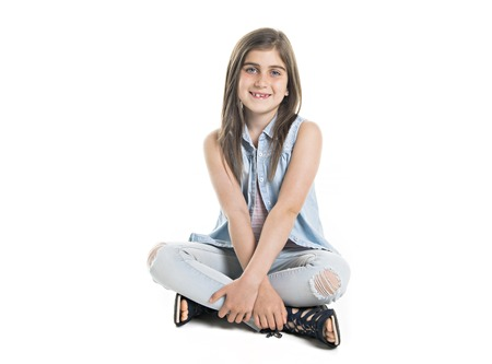 A Studio Portrait of Smiling Girl full body Stok Fotoğraf