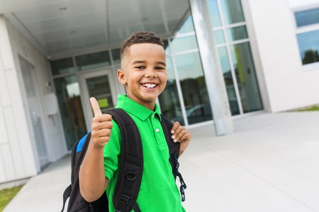 cheerful african american primary school boy with backpack 写真素材 - 112726879