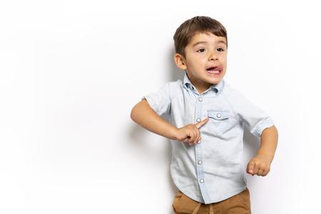 Boy having fun on studio grey background Stok Fotoğraf