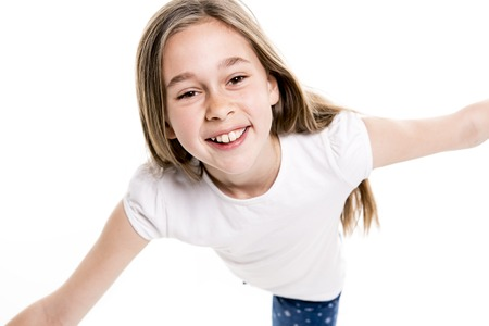 A Portrait of cute, confident 9 years old girl, isolated on white Stock Photo