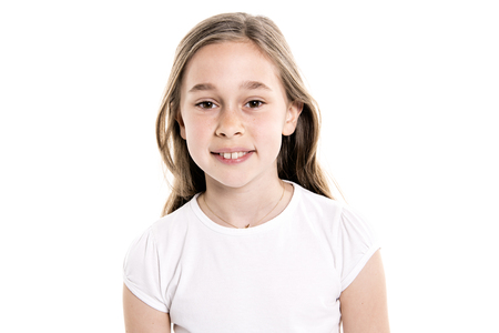 A Portrait of cute, confident 9 years old girl, isolated on white Stockfoto