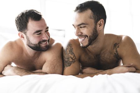 A Handsome men couple on bed together