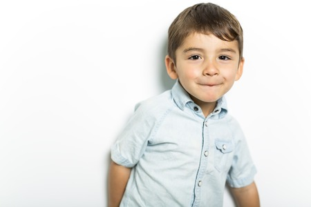 Boy having fun on studio grey background Banco de Imagens
