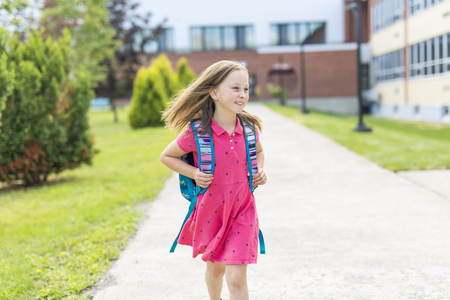 Great Portrait Of School Pupil Outside Classroom Carrying Bags Standard-Bild