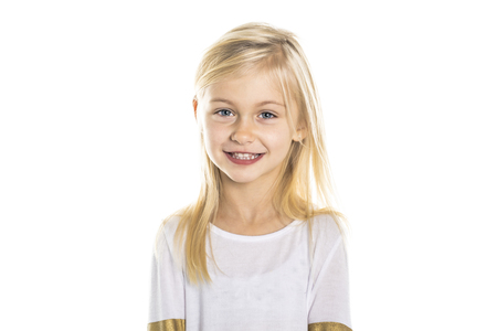 A Cute girl 5 year old posing in studio
