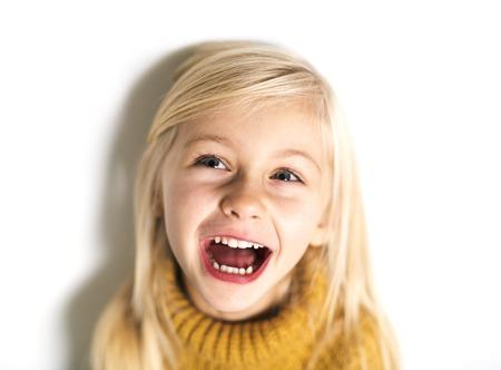 A Cute girl 5 year old posing in studio
