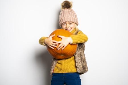 A Cute girl 5 year old posing in studio on autumn season studio Stock Photo