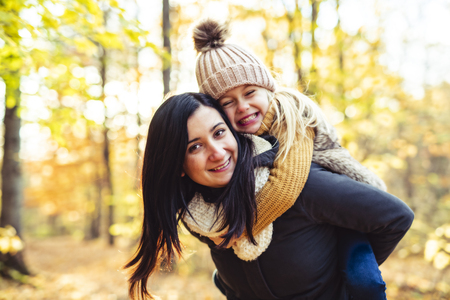 A Happy family on autumn, Mother and daughter in the Park 写真素材