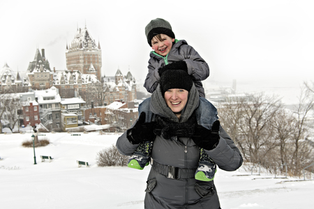 Mother and Son on his shoulder In Snowy Landscape