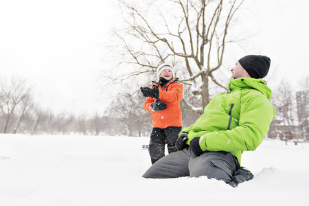 A cute Father And Son In Snowy Landscape
