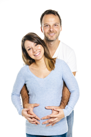 A Pregnant woman with man on studio isolated on white