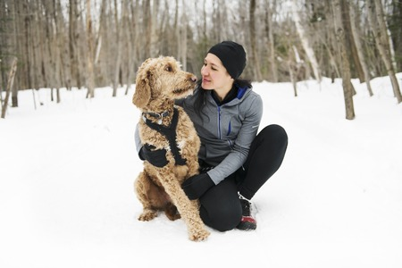 A Nice Woman with goldendoodle winter season