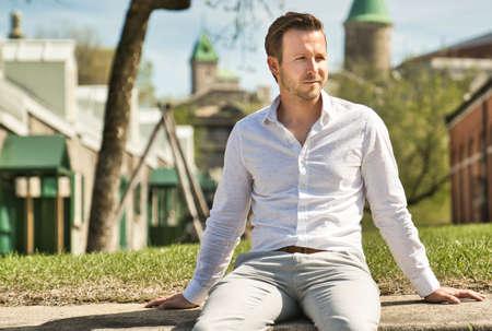Portrait of an handsome man on the urban background Standard-Bild