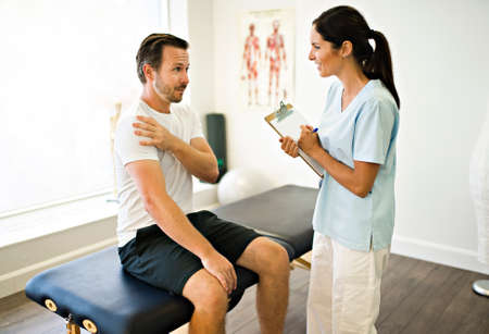 physiotherapist doing treatment with patient in bright office