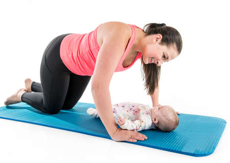 Sport motherhood and active lifestyle of young mother workout together with her baby
