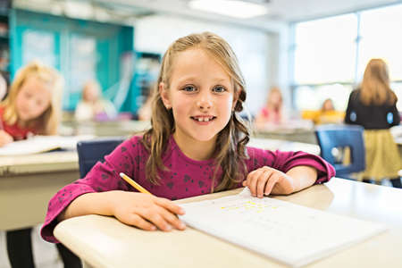 education and school concept little student girl studying at school Standard-Bild