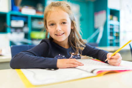 education and school concept little student girl studying at school