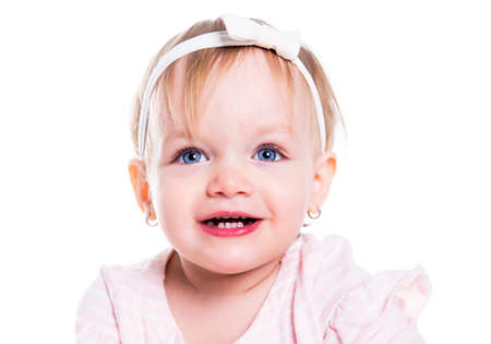 A Portrait of a two year old girl isolated on white background