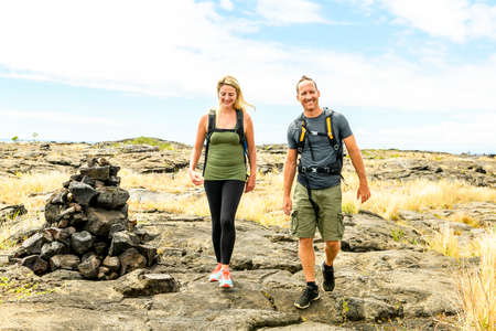 Couple at the Hawaii Volcano National Park, Pu u Loa petroglyphs, amazing walk into the past.