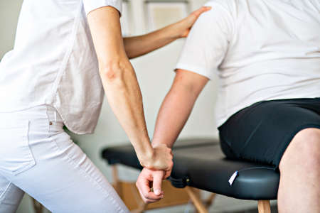 A Modern rehabilitation physiotherapy woman worker with client Stockfoto