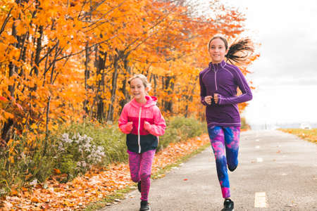 The Healthy lifestyle girl running in park on autumn season