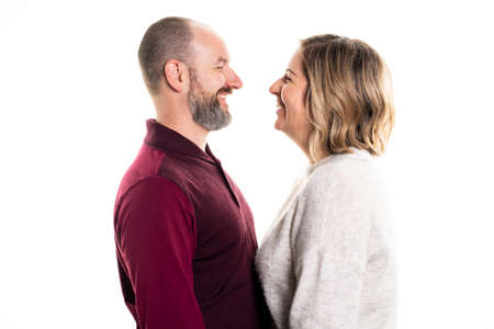 A nice Smiling couple standing on white background