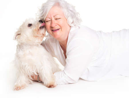 A Elderly woman with her Westie dog