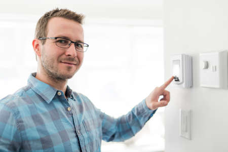 A nice man set the thermostat at house.
