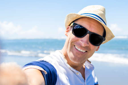 Outdoor portrait of man on the beach.