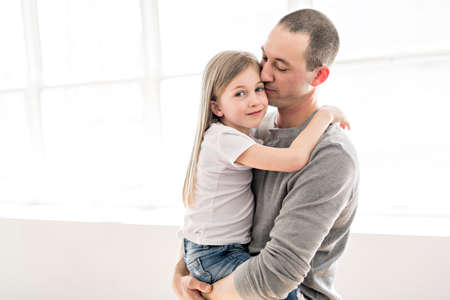 Handsome young father and his cute little daughter