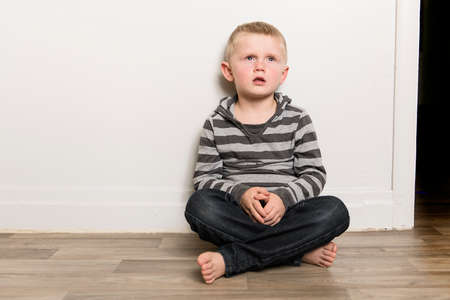 little boy sit on the floor at home