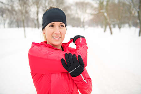 Blond woman running outdoors on a cold winter day